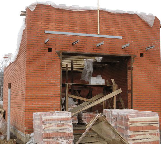 Строительство стен и крыши гараж из кирпича